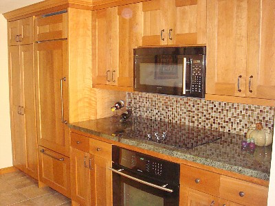 Kitchen w/ custom cabinets, integrated Sub-Zero, range top, oven